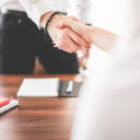 business man and woman handshake in work office